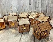 LED světelná girlanda - dřevěné domečky s vločkou