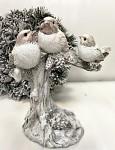 Ptáčci zimní glitter na kmeni stromu